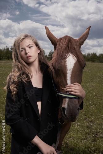 Foto op Aluminium womenART Beautiful young lady with horse