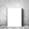 3D blank canvas leaning against a brick wall
