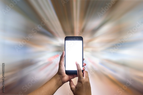 Hand holding a blank screen smart phone on the fast blurred background Poster
