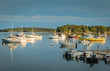 Lobster boats are moored in the harbor at dusk in Friendship, Maine