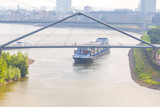 Barge shipping containers on the German Rhein river. - 166078772