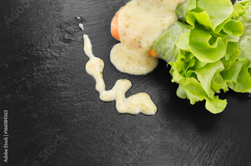 Fresh assorted spring rolls set background. Handmade asian/Chinese spring rolls, Mayonnaise dressing sauce, Wood Cutlery. Rustic concrete background. Spring rolls, vegetables. Space for text