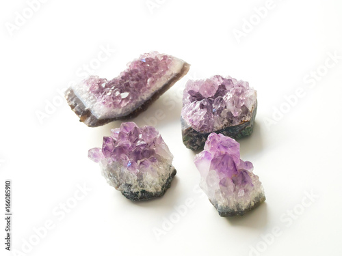 Tuinposter Edelsteen Four Amethyst geodes for crystal therapy treatments and reiki