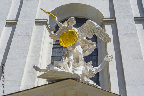 Statue of Saint Michael with gold shield and sword in center of Vienna, Austria