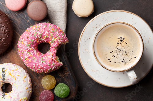 Wall mural Coffee cup and colorful donuts
