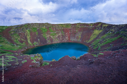 Tuinposter Aubergine Iceland - Magical moment at Kerid Crater Lake with red stones