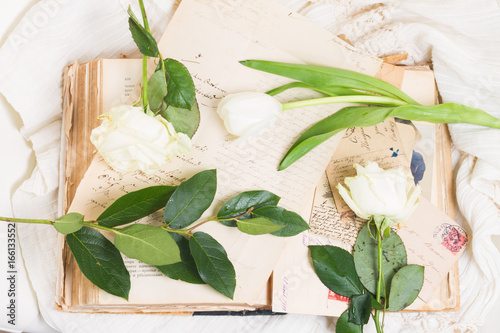 Poster open y book with vintage handwritten letters and fresh flowers