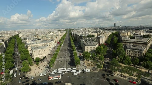 Wall mural Paris skyline aerial view from top of Arc de Triomphe on Champs Elysees street. Distant Tour Eiffel tower Landmark in Paris, France, Europe.