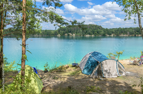 Tourist tents near the shore of a lake