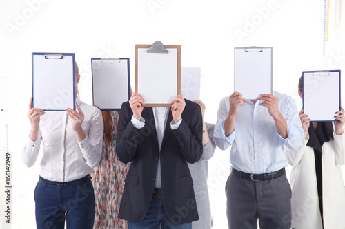 Fridge magnet Team of businesspeople holding a folders near face isolated on white background . Businesspeople.