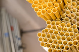 Yellow PVC pipes stacked - 166162593
