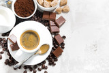 cup of espresso, ingredients and sweets and white background, top view closeup