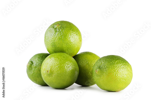 Ripe limes isolated on white background