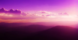Fairytale panorama of mountain ranges in the twilight and clouds, pastel colors