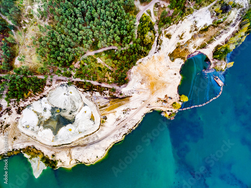 aerial shoot of a lake coast with sand mining, top view