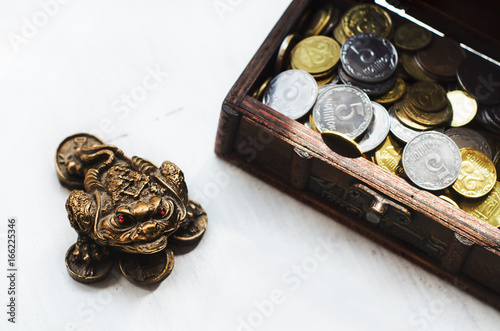 Feng shui money frog figure with coins and box