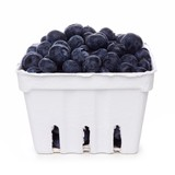 Fresh blueberries in a white paper carton isolated on a white background