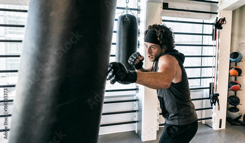 Workspace: Man Takes Out Stress On Punching Bag