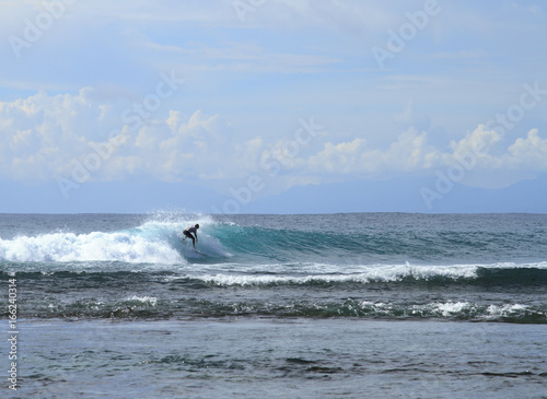 Cool and professional surfers on the waves.Blue Point beach, Uluwatu, Bali island, Indonesia