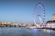 View of the London Eye at sunset. London Eye - a famous tourist attraction over river Thames in the capital city London.