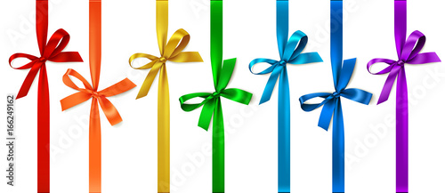 Vector set of decorative bows with vertical ribbon isolated on white.
