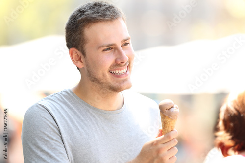 Man walking and holding a chocolate ice cream