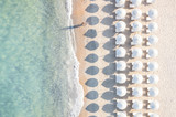 Fototapety Aerial view of amazing beach with white umbrellas and turquoise sea at sunset. Mediterranean sea, Sardinia, Italy.