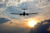 light aircraft flying in the sky at sunset.