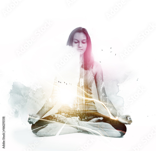 Creative composite of meditating woman and city