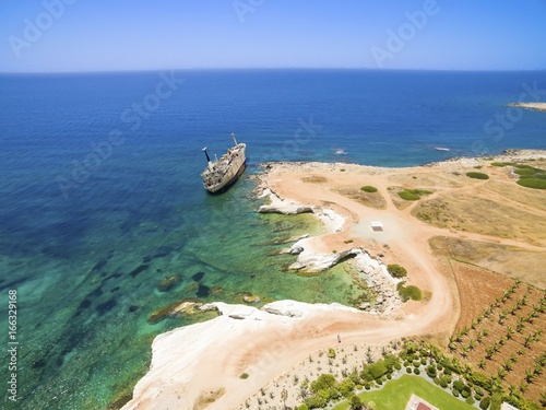Foto op Canvas Schipbreuk Aerial view of abandoned ship wreck EDRO III in Pegeia, Paphos, Cyprus. The rusty shipwreck is stranded on Peyia rocks at kantarkastoi sea caves, Coral Bay, Pafos, standing at an angle near the shore.