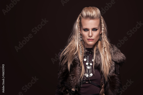 Portrait of viking woman in a traditional warrior clothes. Poster