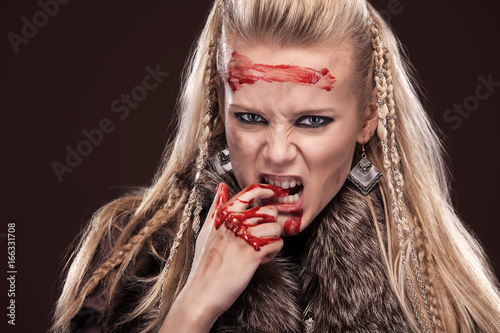 Portrait of viking woman in a traditional warrior clothes Poster