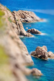Closeup view of rocks in Costa Brava, Catalonia. Miniature tilt shift lens effect