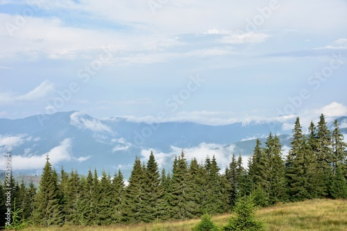 Mountains between white clouds, summer trips