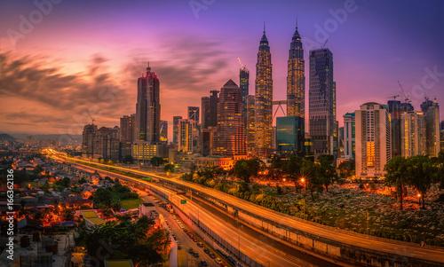 Cityscape of Kuala lumpur city skyline at sunrise in Malaysia.
