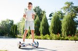 The boy fell from the hoverboard. Lies on the ground - 166378348
