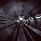 Motion Blur Abstract - in an underground tunnel heading towards a light.  Binary numbers.