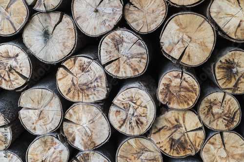 Natural wooden background.closeup of chopped firewood.visible stacked firewood