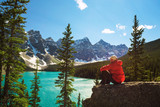 Fototapety Hiker enjoying the view of Moraine lake in Banff National Park, Canada