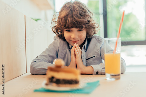 excited little boy looking on cake Poster
