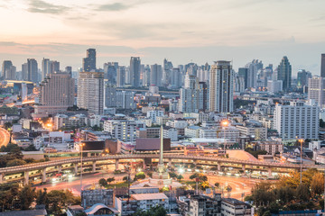 Bangkok City at sunrise time, Hotel and resident area in the capital of Thailand.Top view : modern building in Business bangkok district at Bangkok city with skyline at twilight,Thailand