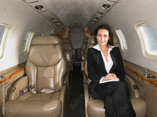 Businesswomen seated in a private jet.