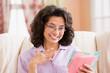 Woman looking at card
