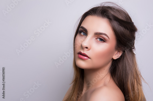 Fashionable portrait of a girl model. Fashion, glamour makeup. Poster
