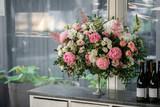 Arrange flowers in a white roman vase