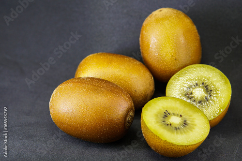 Fresh Yellow Flesh Kiwi Fruit Isolated on black Background.