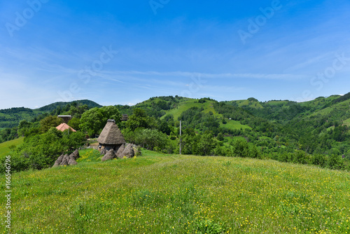 Foto op Canvas Klaprozen Green countryside landscape in the mountains