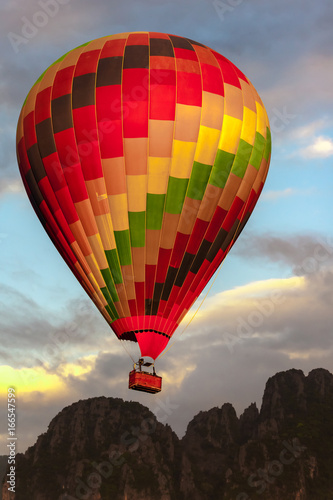 Colorful hot air balloon  Near Mountains  at sunset