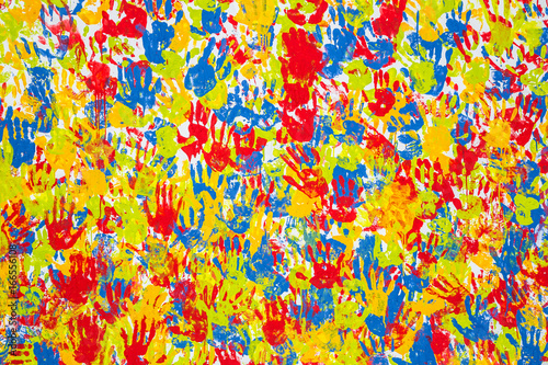 Seamless hands background isolated on white - teamwork concept. Imprint of the children's palm on the canvas. Prints of colored hands. Many children's colorful hands.