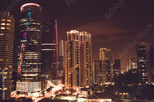 Spectacular night city view. Kuala Lumpur skyscrapers, Malaysia. Business metropolis. Modern buildings. Luxurious travel and tourism. Urban cityscape. Metropolitan architecture. Horizontal